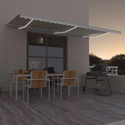 vidaXL Ručně zatahovací markýza s LED světlem 600 x 350 cm krémová